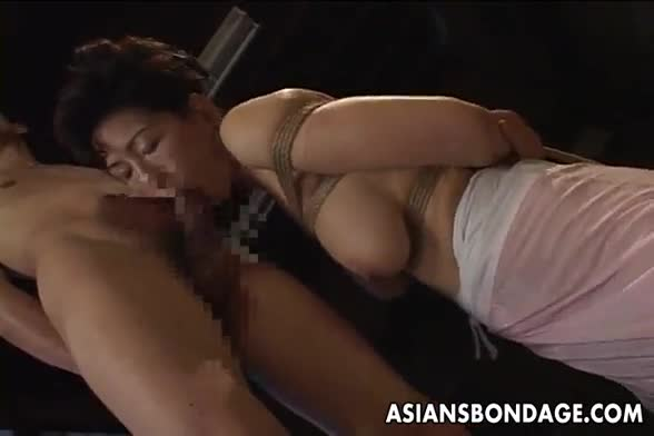 Busty asian slut sucks and slurps on a long cock
