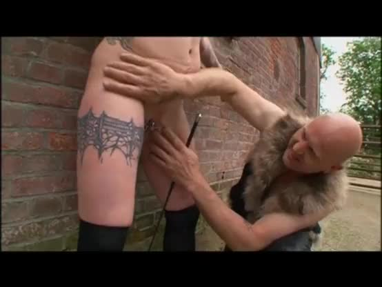 Blonde girl cleaning liking masters boots while spanked riding on strapon on masters leg in the dungeon