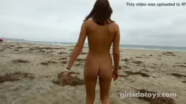 Cute naked girls at the beach