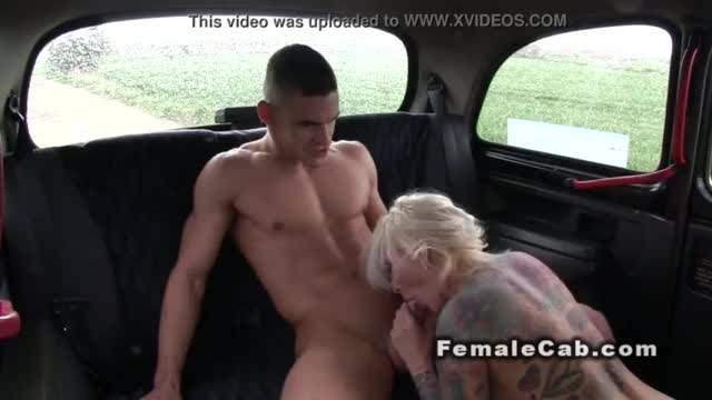 Busty tattooed brit banged in steamy cab