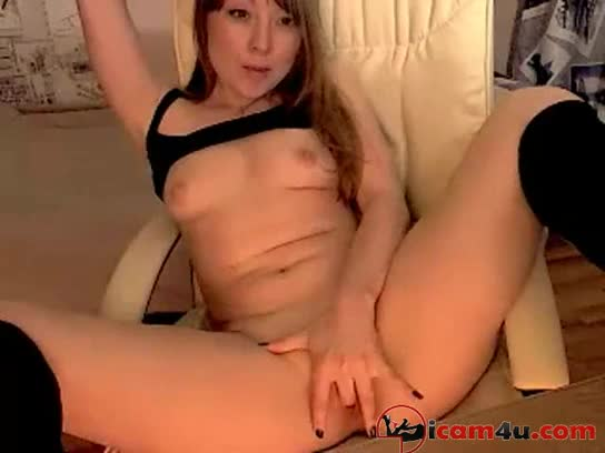 Seductive girl touches her pussy and licks the playful fingers