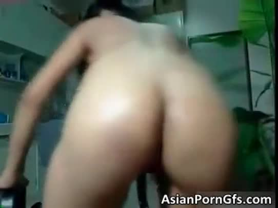 Nasty asian honey takes big dildo in the