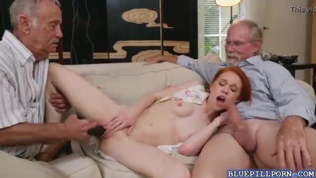 Teen redhead plays with her pussy